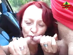 Red mature nympho sucking two