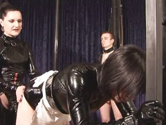 Mistress dominates 2 slaves,