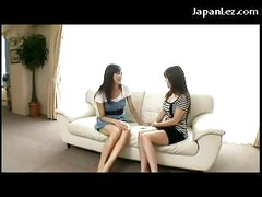 2 Asian Girls Kissing Passionately Sucking Tongues On The Couch<br>