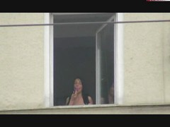 Girlfriend bates on open window in public