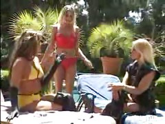 three hot blondes use a strap on outdoors<br>