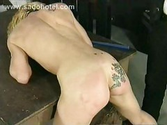 Blond slave undresses and