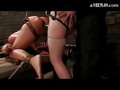 Girl With Tied Legs Getting Pussy And Mouth  Fucked By The Master And Slave Girl With Strapon On The Desk In The Dungeon<br>