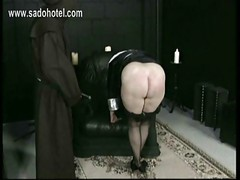 Horny nun slave is spanked on
