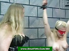 Mistress and master abuse and spank a slavegirl