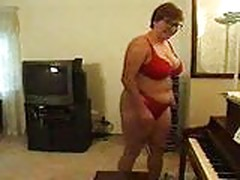 Chubby mature plays piano