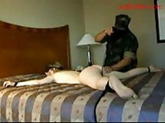 Blindfolded girl tied to bed