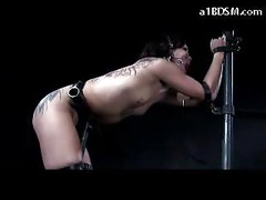 Tattooed Girl Tied To Metal Frame Mouthgag Getting Her Ass Whipped Spanked To Red In The Dungeon<br>