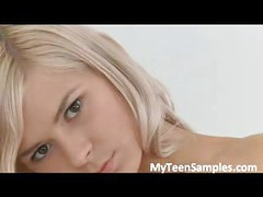 Adorable blonde teenie teases in sexy white<br>