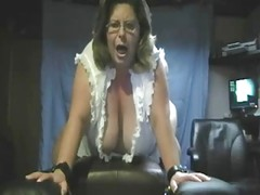 Mature BBW rides a vibrator on cam