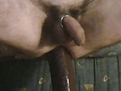 riding big black dildo