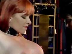 Redhead Slave In Corset