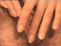 mature woman plays with her hairy pussy<br>