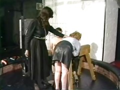 Slave in leather skirt is