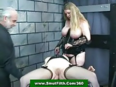Mistress and master torment a female slave