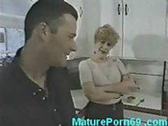 Horny mature fucks younger guy in kitchen