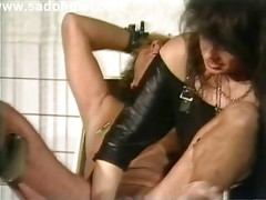 Mistress wearing leather puts