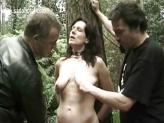 Horny slave is tied to a tree