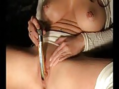 Amateur pierced brunette uses vibrator and mirror