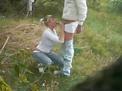 Blonde babe doing a great blowjob outdoor
