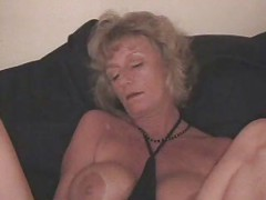 Kinky granny using bottle to