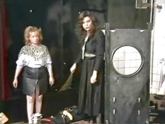 Dominatrix forces slave to