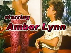 Porn star Amber Lynn gets her pussy stuffed by Tom Byron