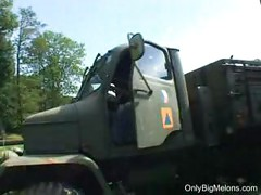 Nikita Valentin smoking in army truck<br>