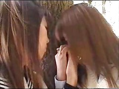2 Schoolgirls In Uniform Kissing Passionately In The Forest<br>