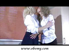 Lesbian co-workers kissing in the office<br>