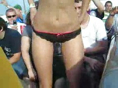 Crazy Girl Doing A Striptease On A Car Event