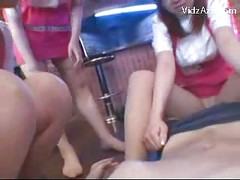 5 Girls In Pantyhoses Pink Dress Rubbing Guy With Their Feets Giving Footjob On The Floor<br>