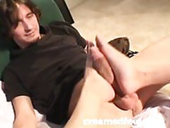 Big breasted blonde chick gives an awesome footjob