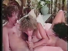 JOHN HOLMES FEEDS TWO BITCHES