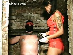 Masked Slave tied up in a