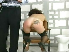 Handcuffed slave bend over a
