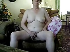 Mature lady totally naked masturbating