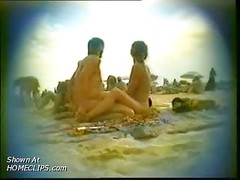Blowjob on a crowded nudist beach