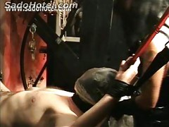 Tied up slave gets choked