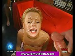 Blonde gets her face completely covered in sperm at bukkake
