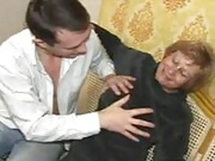 Mature woman in pantyhose with her young lover