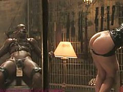 Dominatrix drenches slave