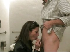 whore sucking a stranger in the men's room