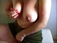 Horny granny rubbing her big clit !