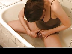 young cute pregnant girl shaves and oil in shower