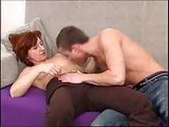 Very attractive mature woman takes it deep in her ass