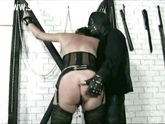 Horny older slave with clamps