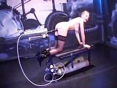 Whore strapped down and machine-dildo fucked